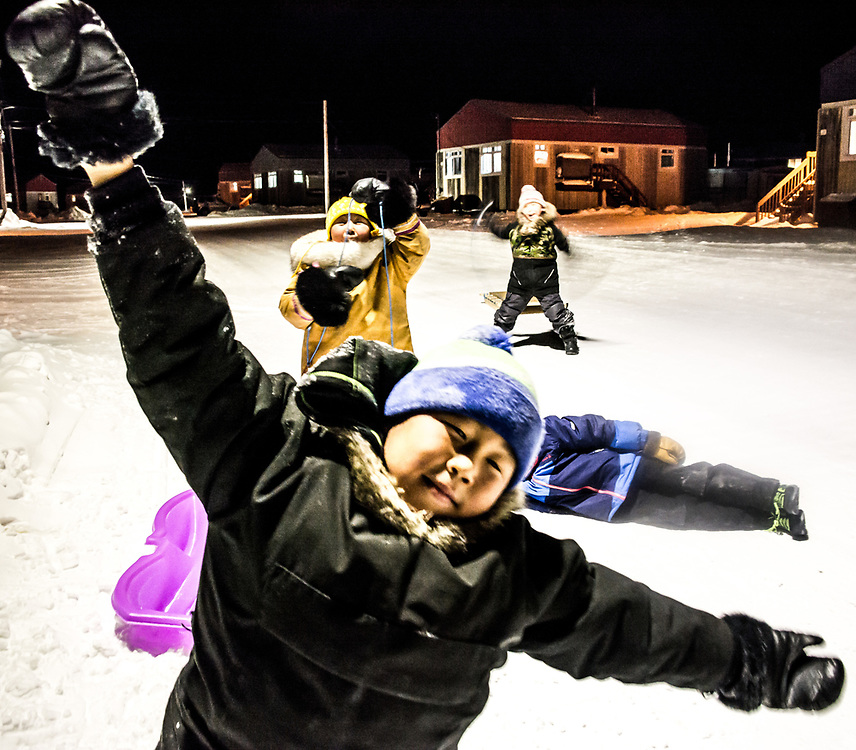 Inuit kids playing out at night in Inukjuak.