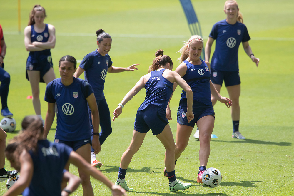 Forward LINDSEY HORAN (with ball) and members of the United States Women's National Team (USWNT) warm up at the new Q2 soccer stadium in Austin during one of the final games on their road to the 2021 Tokyo  Olympics. The team will play a friendly with Nigeria on Wednesday evening.