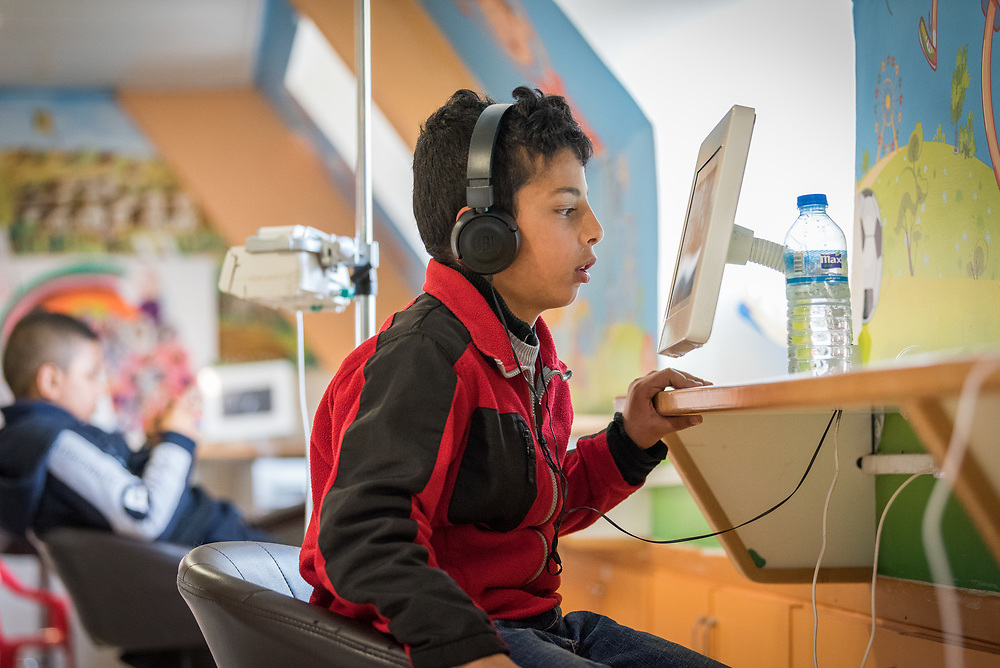 24 February 2020, Jerusalem: Boys watch videos in the paediatric ward of the Augusta Victoria Hospital.