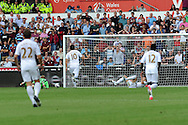 Swansea city's Michu (on ground) bundles the ball over the line for his sides 2nd goal. Barclays Premier league, Swansea city  v West Ham Utd at the Liberty Stadium in Swansea, South Wales  on Saturday 25th August 2012. pic by Andrew Orchard, Andrew Orchard sports photography,