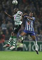 PORTO 08 NOVEMBER  2004: ENAKARHIRE #14 and MCCARTHY #77, in the 9¼ leg of the Super Liga, season 2004/2005, match FC Porto v  Sporting CP, held in Drag‹o stadium,  08/11/2004  20:30<br />(PHOTO BY: NUNO ALEGRIA / AFCD)