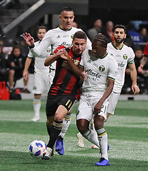 December 8, 2018 - Atlanta, GA, USA - Atlanta United midfielder Eric Remedi (11) and Portland Timbers midfielder Diego Chara (21) battle for the ball during the first half of play as Atlanta wins the MLS Cup 2-0 over the Portland Timbers on Saturday, Dec 8, 2018, in Atlanta. (Credit Image: © Curtis Compton/Atlanta Journal-Constitution/TNS via ZUMA Wire)