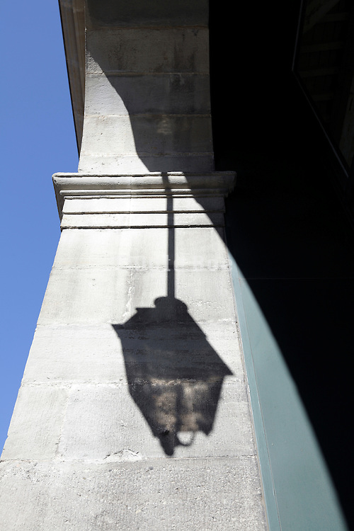 classic streetlight shadow projected on an ancient looking wall