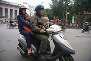 Hanoi, Vietnam, Family of four on a moped