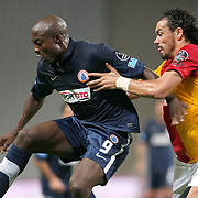 Istanbul BBSpor's Pierre Achille Webo KOUAMO (L) and Galatasaray's Servet CETIN (R) during their Turkish soccer superleague match Istanbul BBSpor between Galatasaray at the Ataturk Olympic stadium in Istanbul Turkey on Sunday 11 September 2011. Photo by TURKPIX
