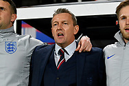 England U21's head coach Aidy Boothroyd singing the National Anthem before kick off during the U21 International match between England and Germany at the Vitality Stadium, Bournemouth, England on 26 March 2019.