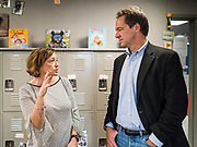 12 SEPTEMBER 2019 - DES MOINES, IOWA: Governor STEVE BULLOCK (D-MT), right, talks to JEANNINE LAUGHLIN, Area Administrator for New Horizons Academy after a Caucus for Kids Facebook Live broadcast sponsored by the Children's Policy Coalition at the school. Gov. Bullock is vying to be the Democratic party's nominee in 2020. He is campaigning in Iowa this week he didn't qualify for the September 12 debate. Iowa traditionally hosts the the first election event of the presidential selection cycle. The Iowa Caucuses will be on Feb. 3, 2020.                     PHOTO BY JACK KURTZ