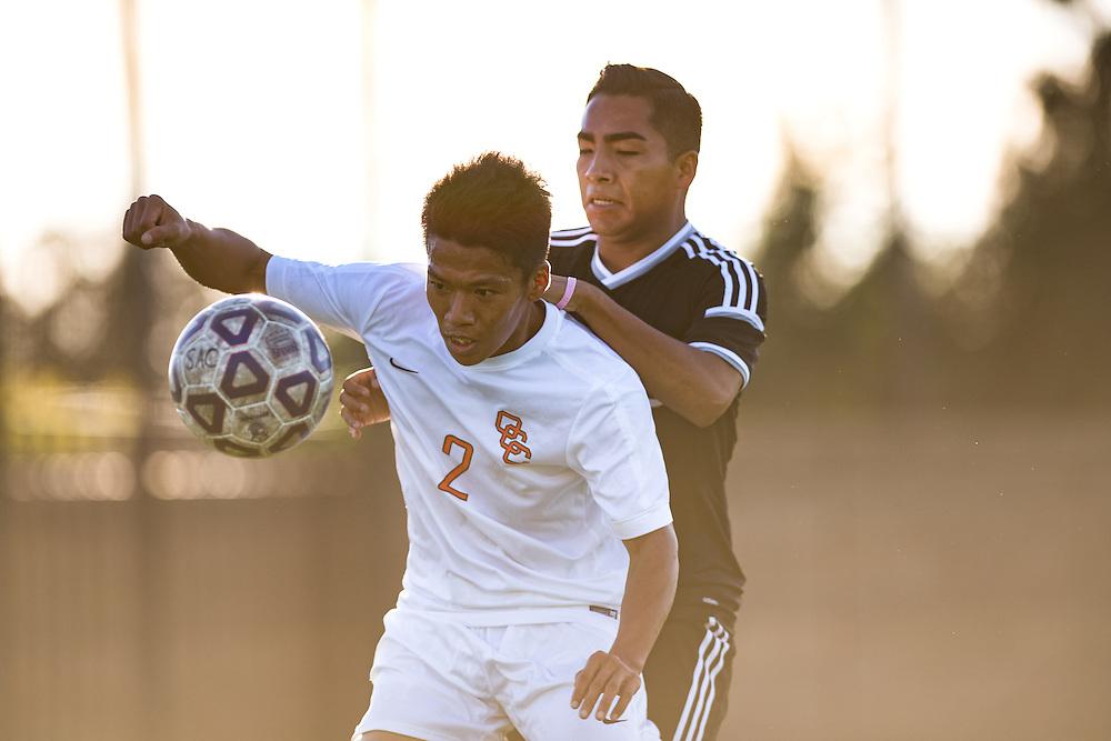Ryota Matsuura blocks the ball from an unidentified Santa Ana defender in Big West Soccer action at Santa Ana College.<br /> <br /> @2016 at Rick May Photography