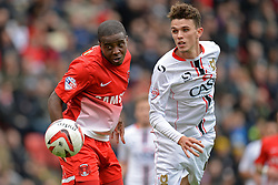 Leyton Orient's Kevin Lisbie heads the ball as Milton Keynes Dons' Tom Flanagan looks on - Photo mandatory by-line: Mitchell Gunn/JMP - Tel: Mobile: 07966 386802 12/10/2013 - SPORT - FOOTBALL - Brisbane Road - Leyton - Leyton Orient V MK Dons - League One