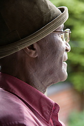 Elderly man gazing out of the window,