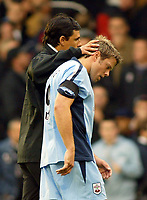 25/9/2004<br />FA Barclays Premiership - Fulham v Southampton - Craven Cottage<br />A disappointed Southampton's James Beattie is consoled by the Fulham manager Chris Coleman after Fulham's 1-0 win scoreline.<br />Photo:Jed Leicester/BPI (back page images)