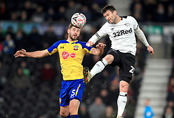 Southampton's Jack Stephens (left) and Derby County's David Nugent battle for the ball during the Emirates FA Cup, third round match at Pride Park, Derby.