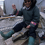 Canada, Nunavut Territory, Town elder working in town of Igloolik.