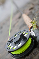 Still life of fly rod and reel in winter.