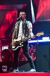 © Licensed to London News Pictures. 24/04/2014. London, UK.   McBusted performing live at The O2 Arena.   In this picture - Matt Willis.  *** LICENSE CONDITIONS USAGE ALLOWED ONLY UNTIL 14 MAY 2014, NO USAGE BEYOND THAT DATE***.  McBusted are an English pop-rock group composed of members of the bands Busted & McFly - James Bourne, Tony Fletcher, Danny Jones, Harry Judd, Dougie Poynter, and Matt Willis.  The only member of the original groups not participating in the new lineup is former Busted singer CharlieSimpson. Photo credit : Richard Isaac/LNP