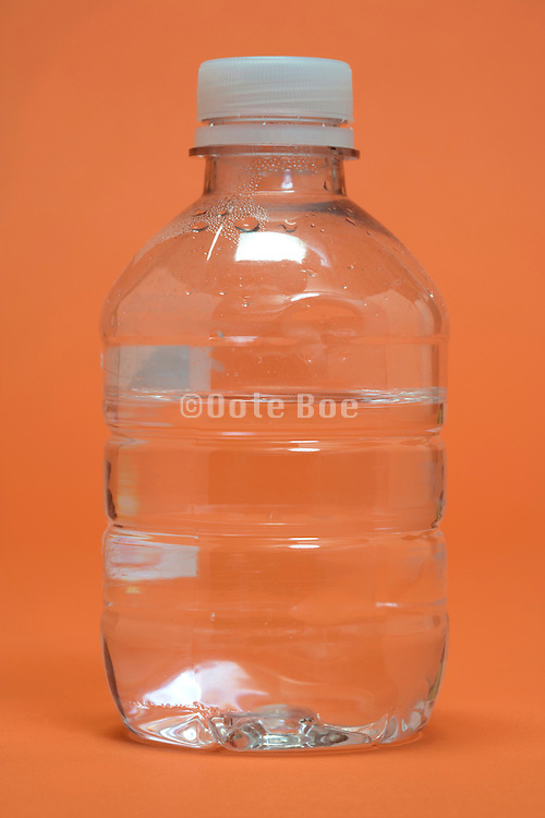 a small plastic bottle containing water