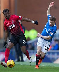 Kilmarnock's Aaron Tshibola (left) and Rangers' Greg Docherty battle for the ball during the Ladbrokes Scottish Premiership match at Ibrox Stadium, Glasgow.