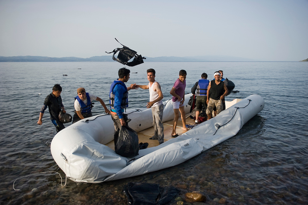 Afghan refugees discard their life jackets after they landed on the beach near Skala Sykaminias in Lesbos island, Greece.Everyday hundreds of refugees, mainly from Syria and Afghanistan, are crossing in small overcrowded inflatable boats the 6 mile channel from the Turkish coast to the island of Lesbos in Greece. Many spend their life savings, over $1000, to buy a space on those boats.