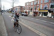 In Utrecht rijden fietsers tegen de forse wind in.<br /> <br /> In Utrecht cyclists are riding with head wind.