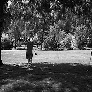 A couple of friends turn a city park into a driving range with clubs and plastic golf balls. The parks are only open for running, walking and jogging, but the closed golf courses and driving ranges leave few alternatives.