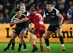 Luke Morgan of Ospreys is tackled by James Davies of Scarlets<br /> <br /> Photographer Craig Thomas/Replay Images<br /> <br /> Guinness PRO14 Round 11 - Ospreys v Scarlets - Saturday 22nd December 2018 - Liberty Stadium - Swansea<br /> <br /> World Copyright © Replay Images . All rights reserved. info@replayimages.co.uk - http://replayimages.co.uk