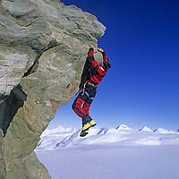 "Alex Lowe (MR) climbs on Peak 3950m (""Pyramid Peak"") in Antarctica's Ellsworth Mountains."