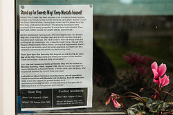 A notice calling for eviction resistance in the window of a property on the Sweets Way housing estate on 23rd September 2015 in London, United Kingdom. A group of housing activists calling for better social housing provision in London had occupied some of the properties on the 142-home estate in Whetstone, in some cases refurbishing properties intentionally destroyed by the legal owners following eviction of the original residents, in order to try to prevent or delay the eviction of Mr Aliverdipour and the planned demolition and redevelopment of the entire estate by Barnet Council and Annington Property Ltd.