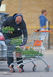 ©Licensed to London News Pictures 30/04/2020  <br /> Dartford, UK. A man loading his flowers into the car outside B&Q warehouse store in Dartford, Kent. B&Q have today opened all of its 288 stores in the UK. The DIY retailer has strict social distancing measures in place. Photo credit:Grant Falvey/LNP