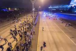 September 22, 2016 - Charlotte, North Carolina, United States of America - September 22, 2016 - Charlotte, NC, USA - Protestors and police on the highway during a third day of protests in Charlotte, North Carolina on Thursday, Sept. 22, 2016. This is the third day of protests that erupted after a police officer's fatal shooting of an African-American man Tuesday afternoon and the first full day of a declared State of Emergency by the governor. (Credit Image: © Sean Meyers via ZUMA Wire)