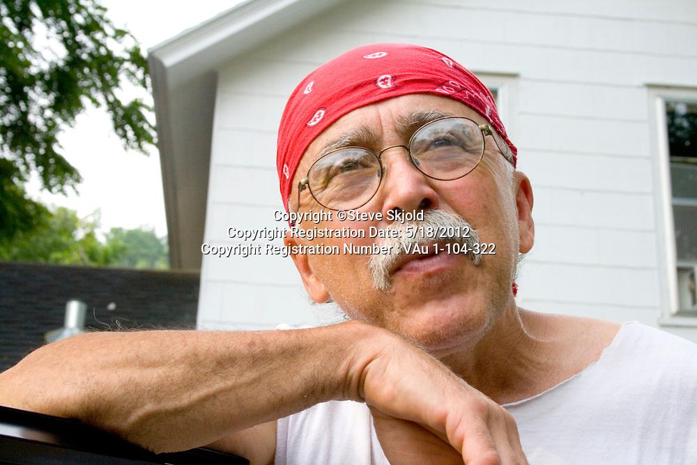 Colorful resident of Lanesboro outside his home. Lanesboro Minnesota MN USA