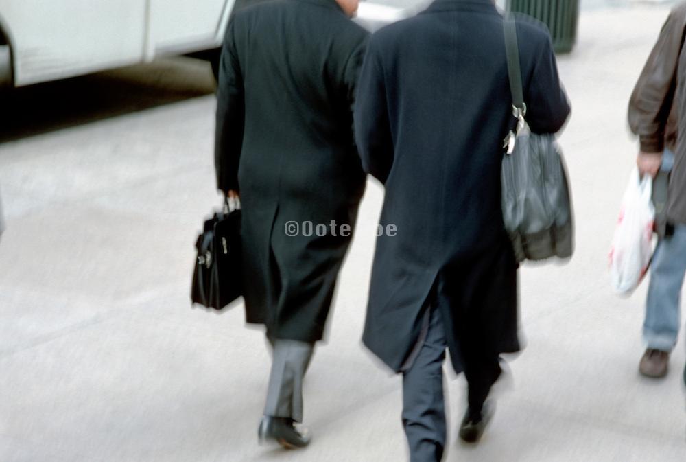 2 businessmen walking in city