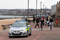 Portobello, Edinburgh, Scotland, UK. 5 April, 2020. On the second Sunday of the coronavirus lockdown in the UK the public are outside taking their daily exercise. Pictured. Police patrol Portobello Promenade and beach a popular weekend retreat for residents of Edinburgh. Iain Masterton/Alamy Live News