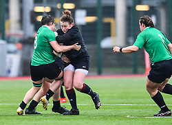 Wales women's Caryl Thomas is tackled by Ireland women's Ciara Griffin<br /> <br /> Photographer Craig Thomas/Replay Images<br /> <br /> International Friendly - Wales women v Ireland women - Sunday 21th January 2018 - CCB Centre for Sporting Excellence - Ystrad Mynach<br /> <br /> World Copyright © Replay Images . All rights reserved. info@replayimages.co.uk - http://replayimages.co.uk