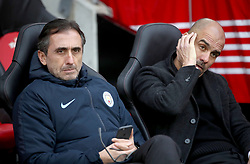 """Manchester City manager Pep Guardiola (right) and Head of Player Support and Protocol Manel Estiarte prior to the beginning of the Premier League match at St Mary's Stadium, Southampton. PRESS ASSOCIATION Photo. Picture date: Sunday December 30, 2018. See PA story SOCCER Southampton. Photo credit should read: Adam Davy/PA Wire. RESTRICTIONS: EDITORIAL USE ONLY No use with unauthorised audio, video, data, fixture lists, club/league logos or """"live"""" services. Online in-match use limited to 120 images, no video emulation. No use in betting, games or single club/league/player publications."""