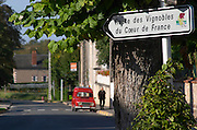 Sign with Route des Vignoble, Wine Route. Old red Reanult 4. Montigny village, Sancerre, Loire, France