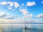 """Key Largo, Florida, called """"the first of the Florida Keys,"""" because of its northernmost location along the Florida Keys chain. It is known for having superb diving and water sports."""
