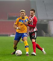 Football - 2020 / 2021 FA Cup - Round One - Sunderland vs Mansfield Town - Stadium of Light<br /> <br /> Kellan Gordon of Mansfield Town vies with Callum McFadzean of Sunderland<br /> <br /> <br /> COLORSPORT/BRUCE WHITE