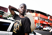 A boy carries a water jug through the streets of Monrovia on August 1, 2011.