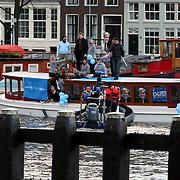 """NLD/Amsterdam/20080201 - Verjaardagsfeest Koninging Beatrix en prinses Margriet, protestactie '"""" Laat je snor staan'"""" tegen kanker door Aram van der Rest Mohammed Chaara en Dennis van der Geest, politie geeft een waarschuwing"""