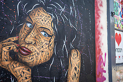 © Licensed to London News Pictures. 23/07/2021. LONDON, UK.  Detail of a mural of Amy Winehouse by street artist Otto Schade in Hawley Street in Camden Town on the tenth anniversary of the late singer's death.  Photo credit: Stephen Chung/LNP