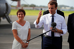 France's President Emmanuel Macron addresses the media with French Overseas Minister Annick Girardin, left, on the tarmac of Pointe-a-Pitre airport, upon his arrival in the Guadeloupe island, the first step of his visit to French Caribbean islands, Tuesday, Sept. 12, 2017. Photo by Christophe Ena/Pool/ABACAPRESS.COM