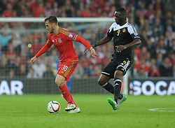 Aaron Ramsey of Wales (Arsenal) shields Christian Benteke of Belgium (Aston Villa) - Photo mandatory by-line: Alex James/JMP - Mobile: 07966 386802 - 12/06/2015 - SPORT - Football - Cardiff - Cardiff City Stadium - Wales v Belgium - Euro 2016 qualifier