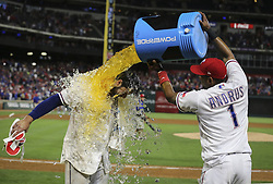 May 12, 2017 - Arlington, TX, USA - Texas Rangers' Joey Gallo (13) gets showered in powerade by Elvis Andrus (1) after a game-winning three-run home run in the ninth inning to beat the Oakland Athletics 5-2 on Friday, May 12, 2017 at Globe Life Park in Arlington, Texas. (Credit Image: © Richard W. Rodriguez/TNS via ZUMA Wire)