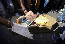 Wednesday 26 October 2016.<br /> Parliament, Cape Town,<br /> Western Cape,<br /> South Africa<br /> <br /> Fees Must Fall Protest March In Cape Town.<br /> <br /> Protesters burn a picture of Blade Nzimande and a cardboard coffin while protesting outside Parliament in Cape Town.<br /> <br /> Students and supporters march to parliament in protest against higher education fees in South Africa on the 26th October 2016. The students are protesting against the fees for higher education. This protest is part of the #FeesMustFall campaign.<br /> <br /> Picture By: Mark Wessels/ RealTime Images.
