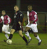 Picture: Raymond Field<br /><br /><br />Woking F.C v Kidderminster Harriers FA second round<br /><br />06/12/2003<br /><br /><br />Danny Williams has the upper hand on Davis Haule