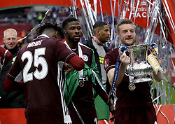 Leicester City's Jamie Vardy celebrates with the trophy after winning the Emirates FA Cup Final at Wembley Stadium, London. Picture date: Saturday May 15, 2021.