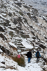 © Licensed to London News Pictures. 22/01/2019. Snowdonia, Gwynedd, Wales, UK.  Hikers set off to climb Mount Snowden as snow showers continue in Snowdonia National Park, Gwynedd, UK. credit: Graham M. Lawrence/LNP