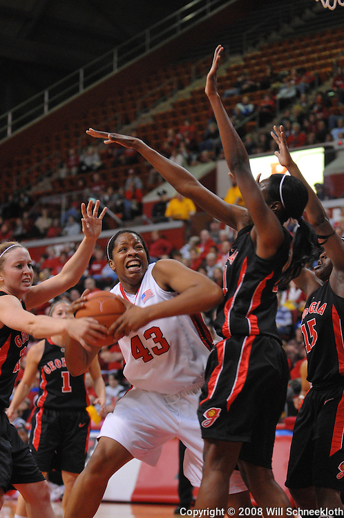 Dec 7, 2008; Piscataway, NJ, USA; Rutgers center Rashidat Junaid (43) battles Georgia Lady Bulldog defenders under the hoop during the first half of Rutgers' 45-34 victory over Georgia in the Jimmy V Classic at Louis Brown Athletic Center.