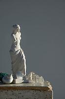 Roman Greek Venus de Milo Aphrodite statue sculpture Venus de Milo Aphrodite statue photograph with gray tone background.