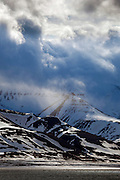 """Dramatic clouds over the mountains, in Adventfjorden, Longyearbyen, Spitsbergen, in the Arctic archipelago of Svalbard This mage can be licensed via Millennium Images. Contact me for more details, or email mail@milim.com For prints, contact me, or click """"add to cart"""" to some standard print options."""